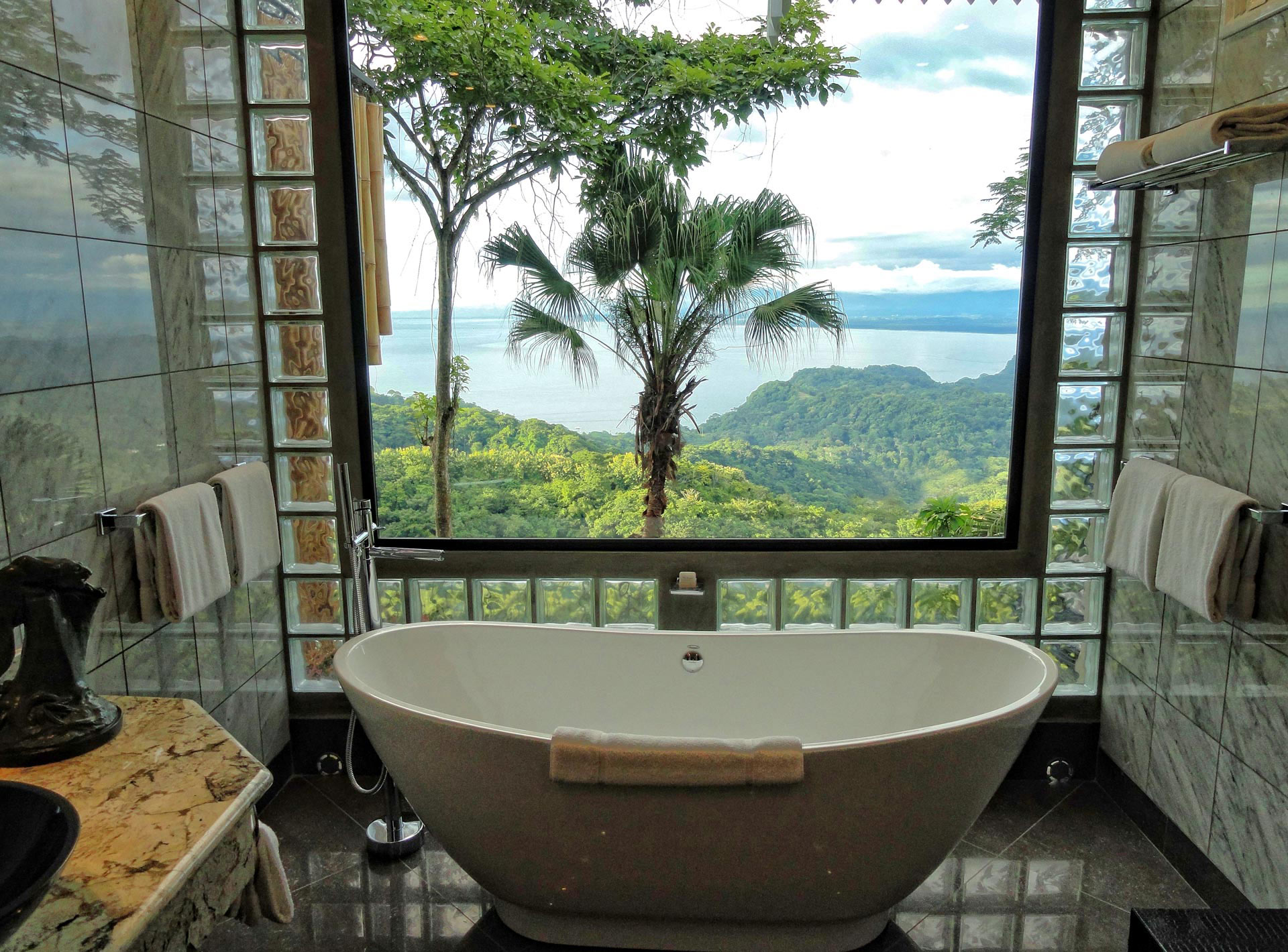 bath with a view at Villa Caletas